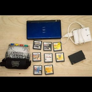 DS Lite with 8 games charger and gameboy adapter